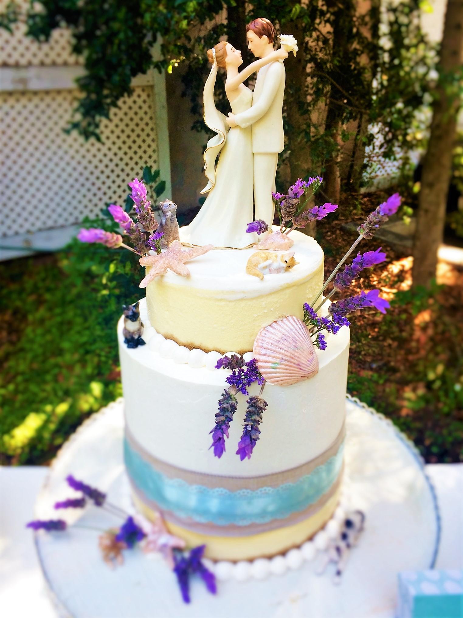 """3 tiered: 6"""" cheesecake / 8"""" lemon cake / 9"""" cheesecake"""