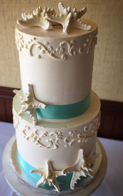 """2 tiered: 6"""" / 8"""" beach theme with piping"""