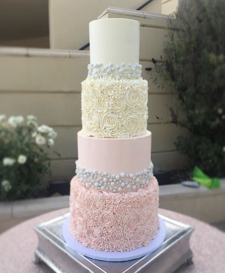 """4 tiered"""" 6"""" classic simple with pearls / 8"""" ruffle rosettes / 10"""" tall light pink classic simple with pearls / 12"""" tall light pink ruffle rosettes"""